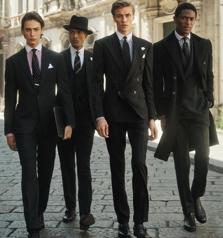 しっかりとした色合いのピンストライプのスーツとネクタイを着用した男性